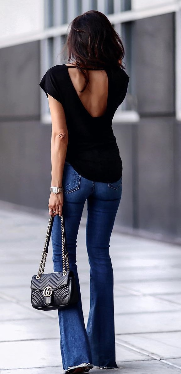 Black Open Back Top, Denim Jeans And Handbag