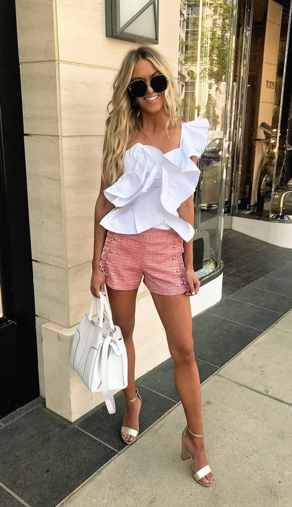 White One Shoulder Ruffle Top, Red Shorts. High Heels And White Handbag