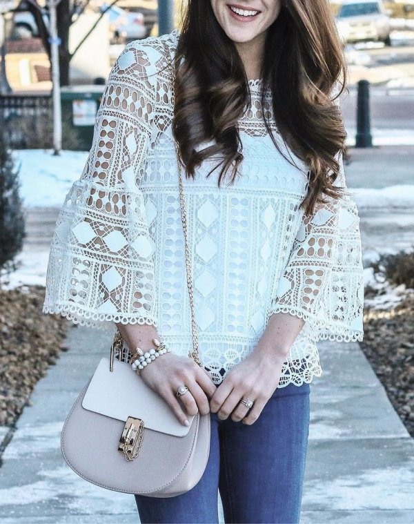 White Shear Lace Top Paired With Blue Jeans And Crossbody Bag