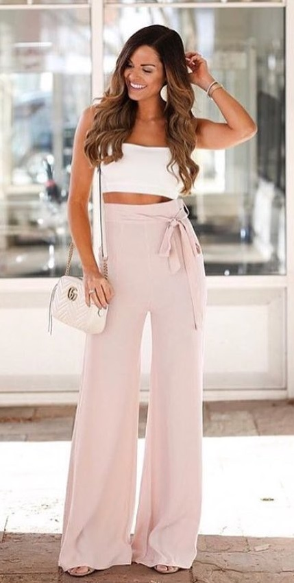 White Sleeveless Crop Top And Pink Loose Bottom Trouser