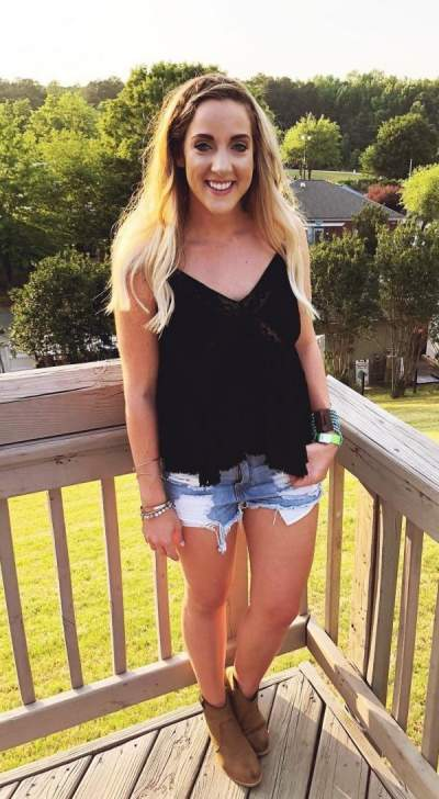 Alluring Ripped Shorts, Black Cami Top And Ankle Shoes