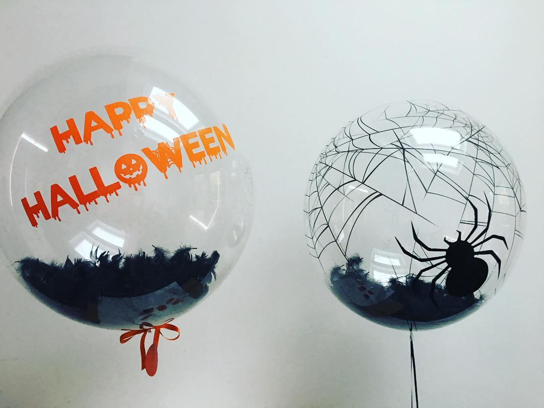 Black Feathers And Spider In Balloons