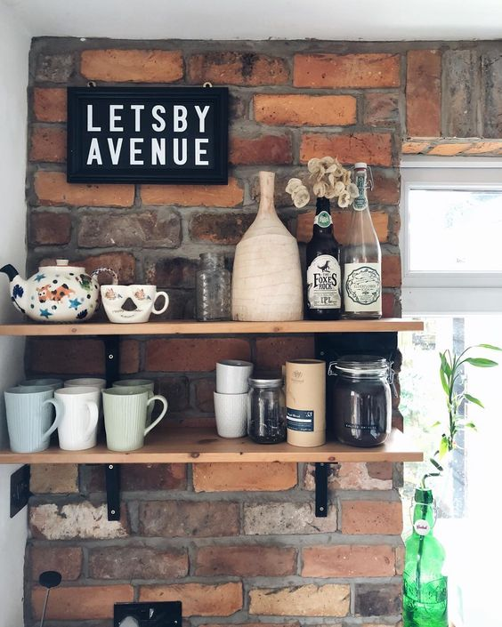 Brick Wall With Wooden Shelves For Kitchen Tools