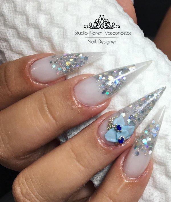 13 Charismatic Silver Glitter Stiletto Nails With Accessory Via