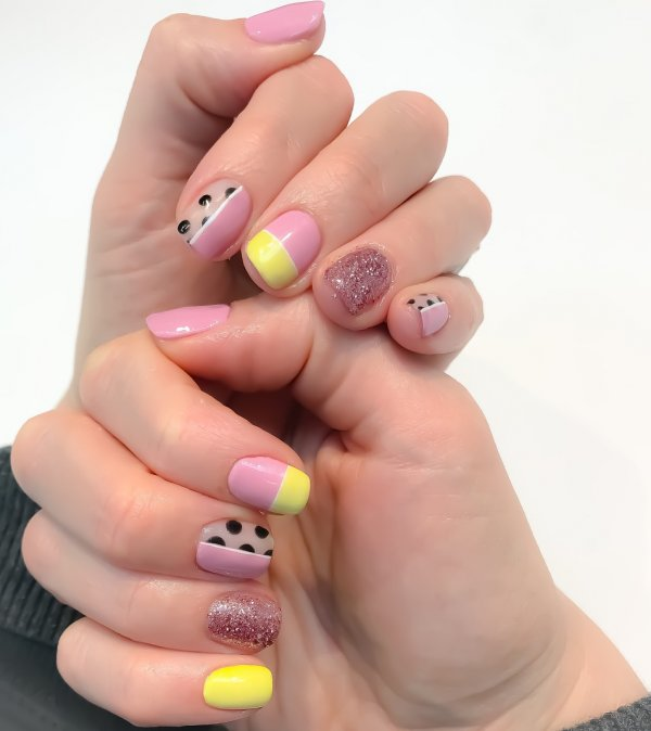 Charismatic Yellow And Pink Nails With Black Polka Dots