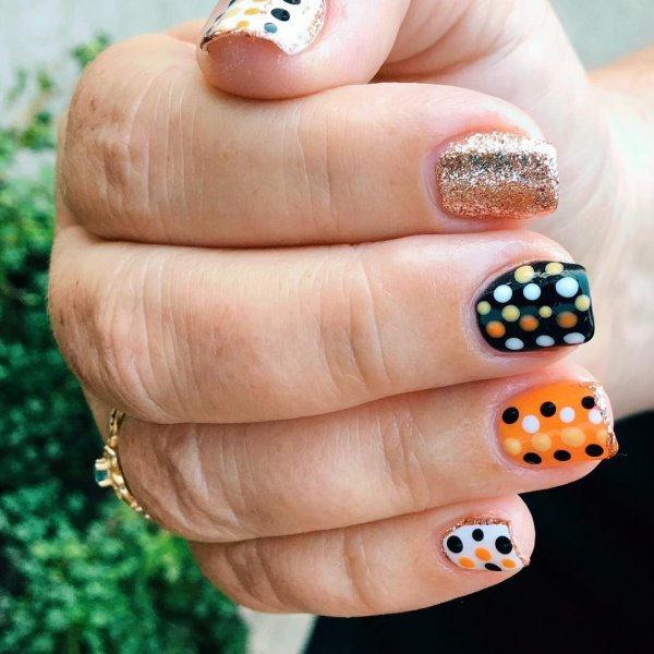 Dazzling Orange and Black Polka Dot Nail Art Design