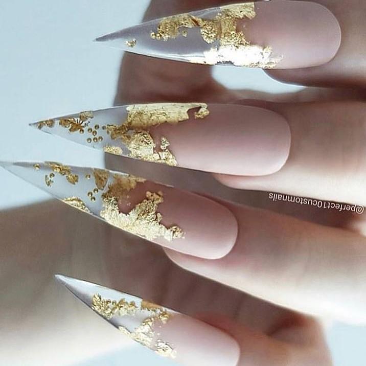 Edgy Golden Foil Stiletto Nails