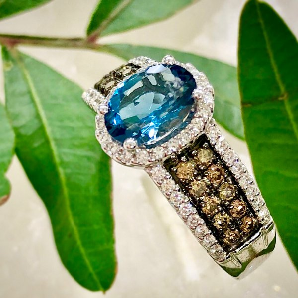 Specular Deep Blue Topaz Stone With Chocolate And Vanilla Diamonds In Engagement Ring