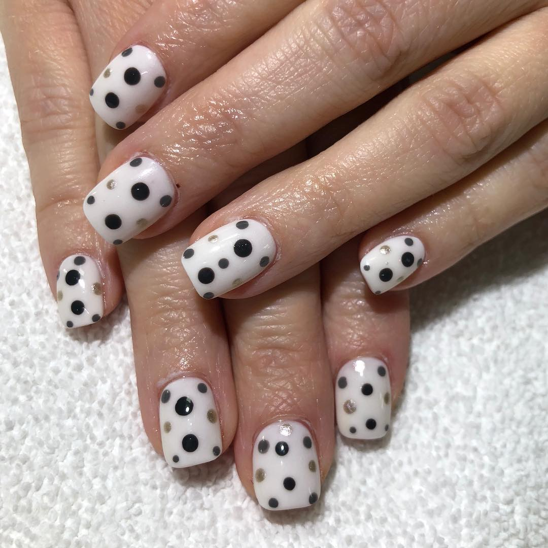Tidy White Nail Color With Black And Gray Dots