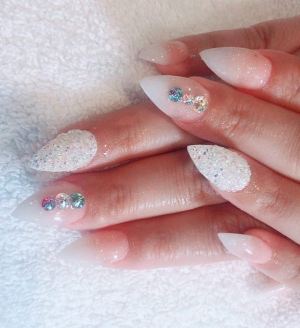 White Stiletto Nails Decorated With Swarovski Crystals