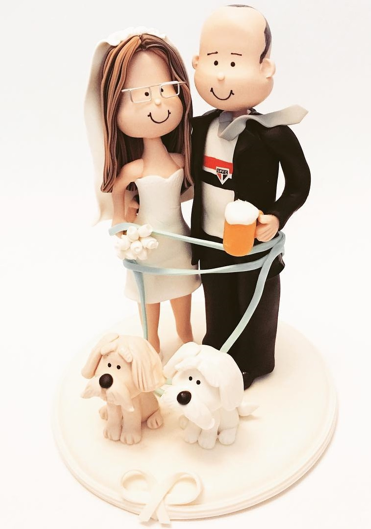 Absolute sweet wedding cake topper with puppies