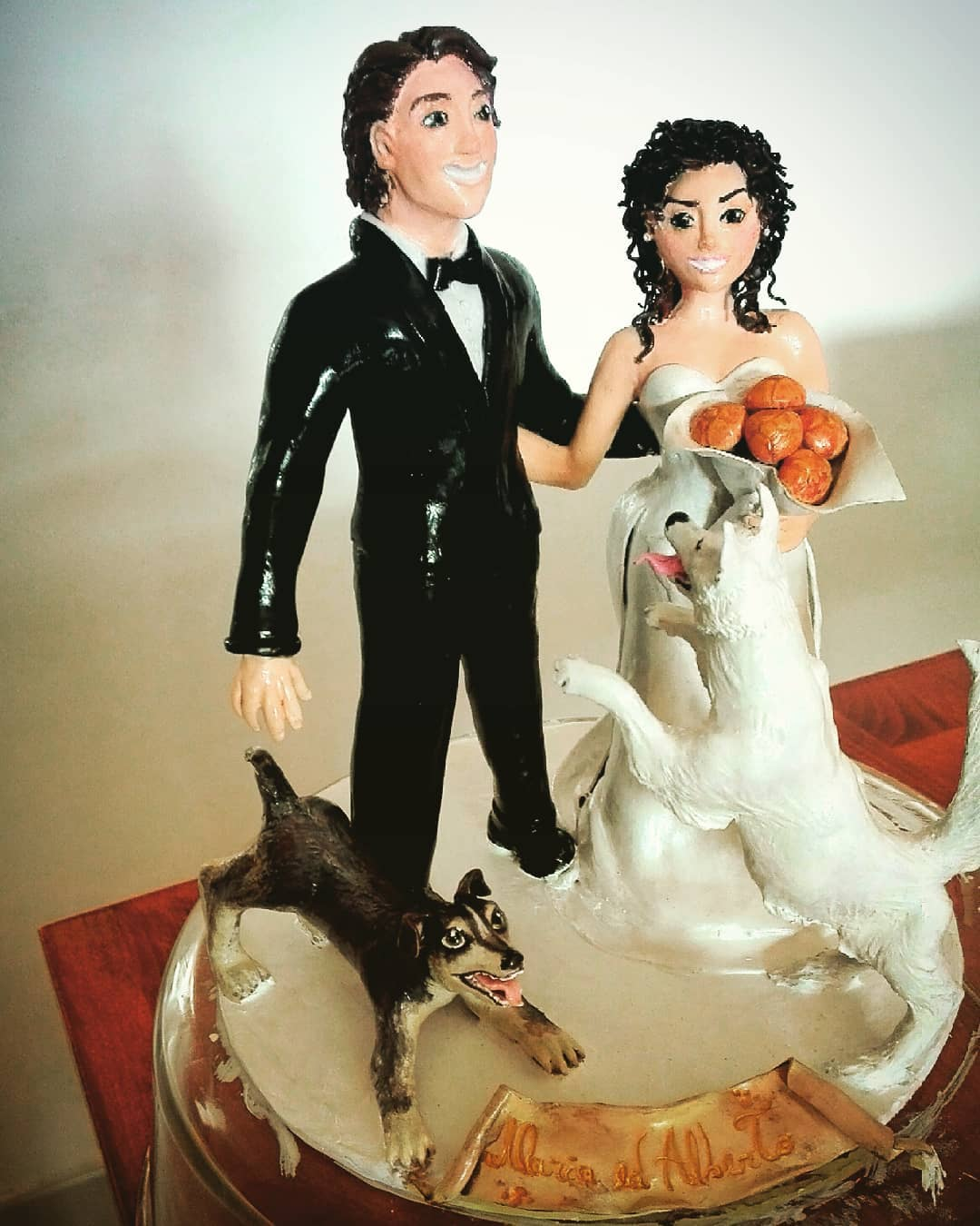 Beautiful couple with dog wedding cake toppers