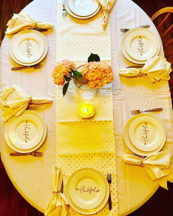 Beautifully decorated table with flowers and candle for thanksgiving