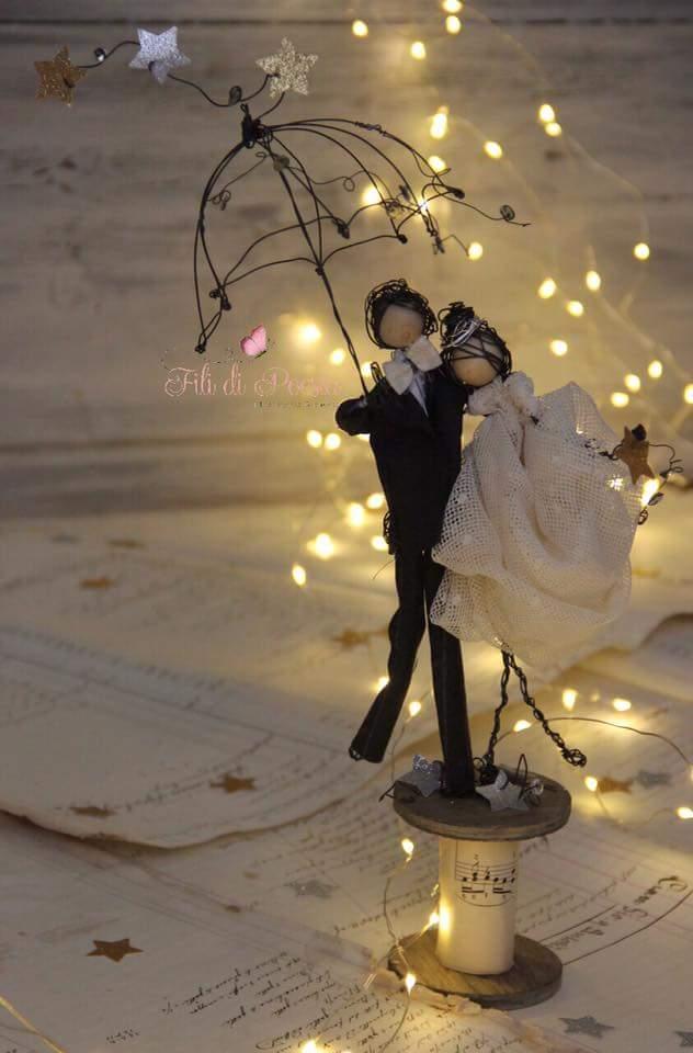 Creative umbrella couple wedding cake topper