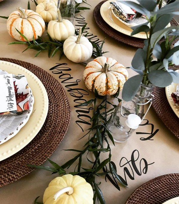 Dashing hand printed table cover decorated with pumpkins