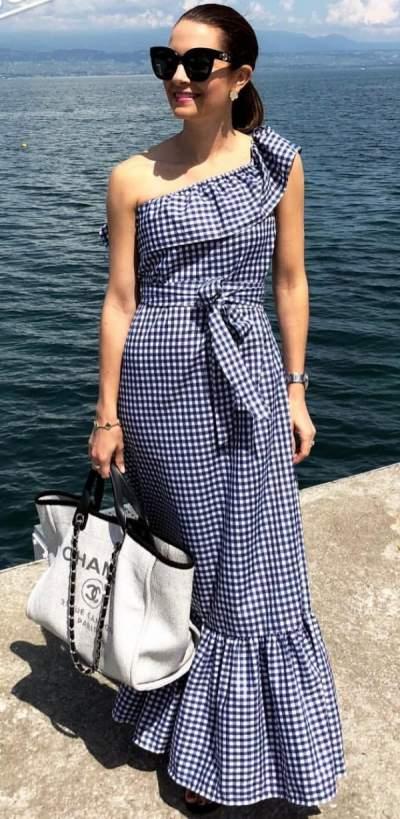 58c6cdbb065 Gingham print one shoulder maxi dress with off-white handbag and sunglasses