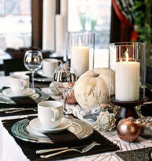 Lovely silver, golden and white pumpkins on table with candle