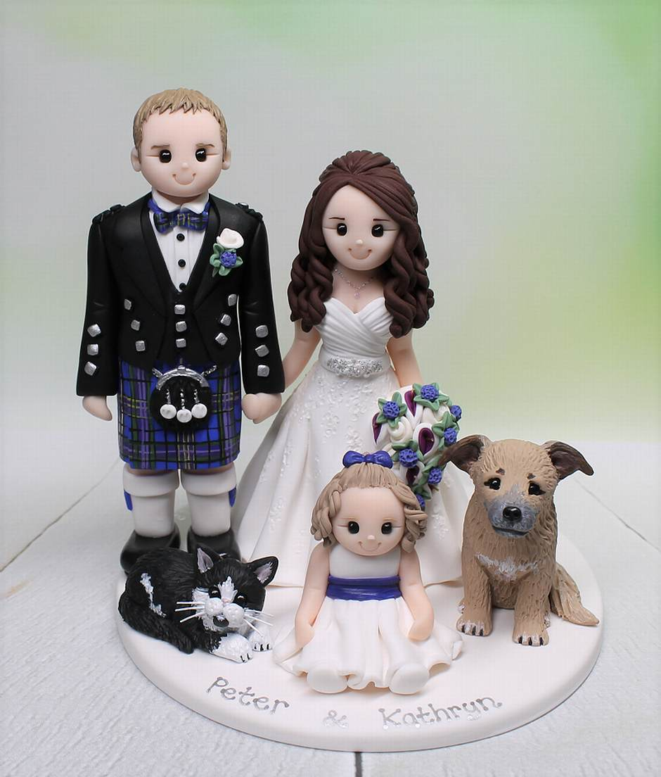 Most memorable wedding cake topper with their daughter and pets