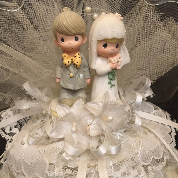 Perfectly themed wedding cake topper