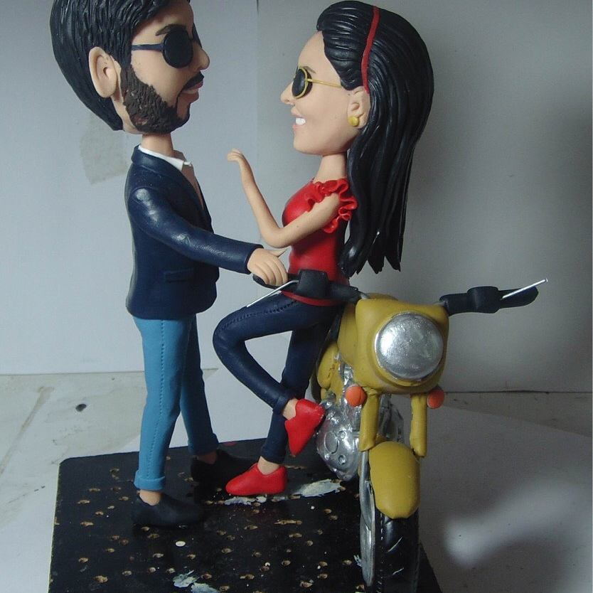 Pretty moterbike cake topper bride and groom