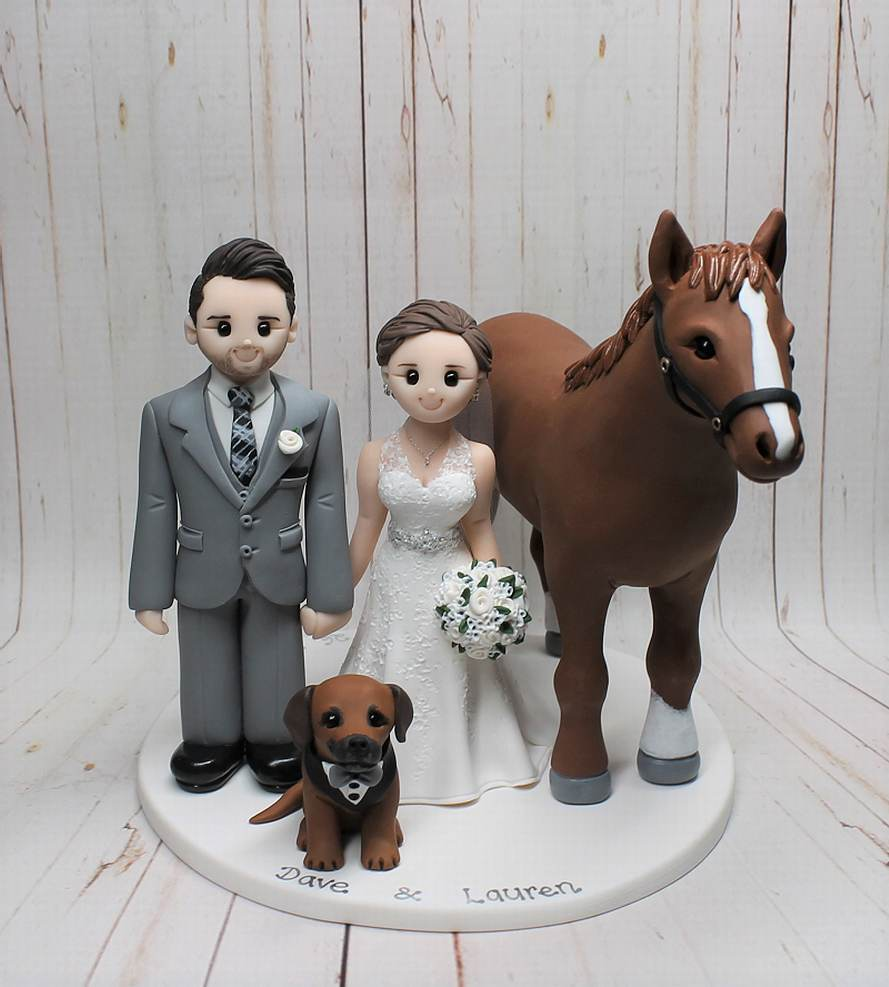 Superbly designed wedding cake topper with their horse and smartly dressed dog