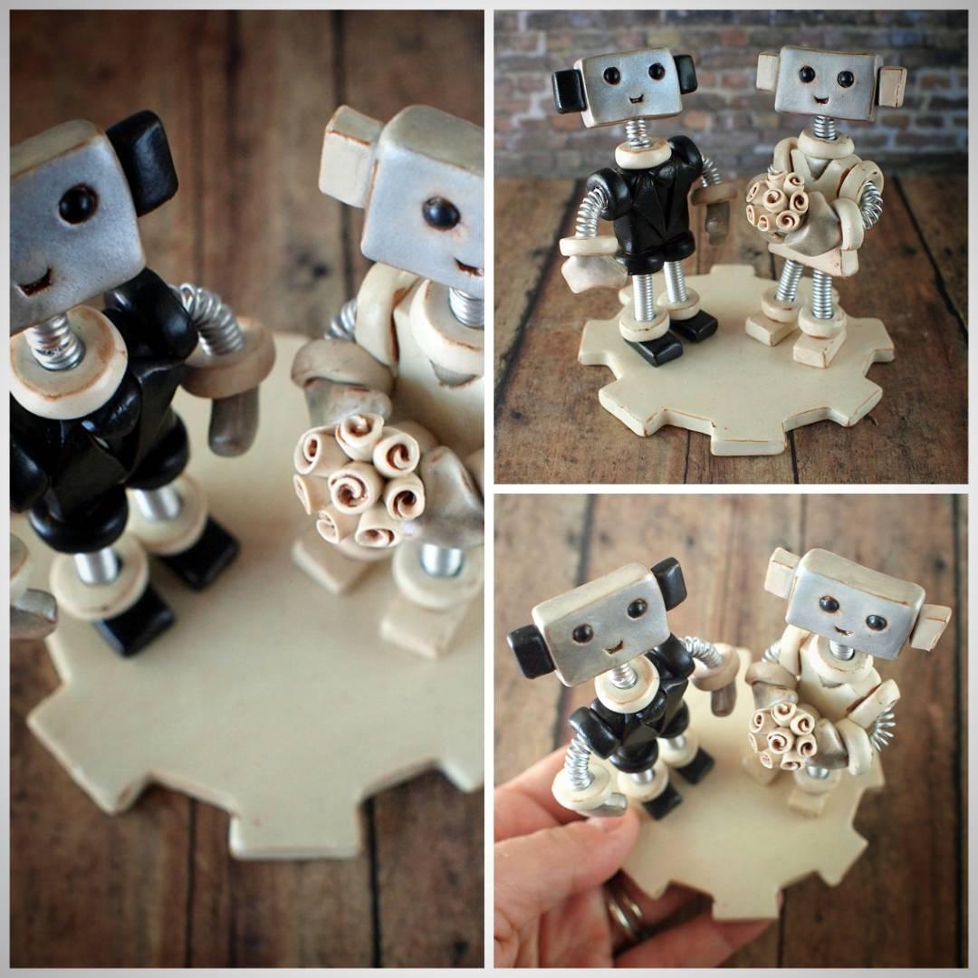Swanky robotic couple wedding cake topper