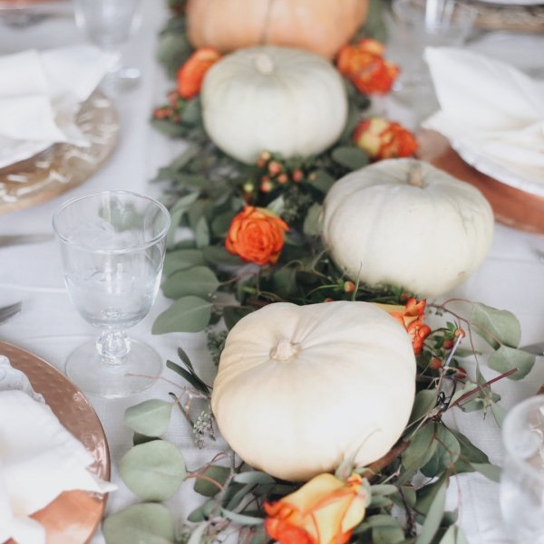 White pumpkins with fresh flowers and leaves looks amazing