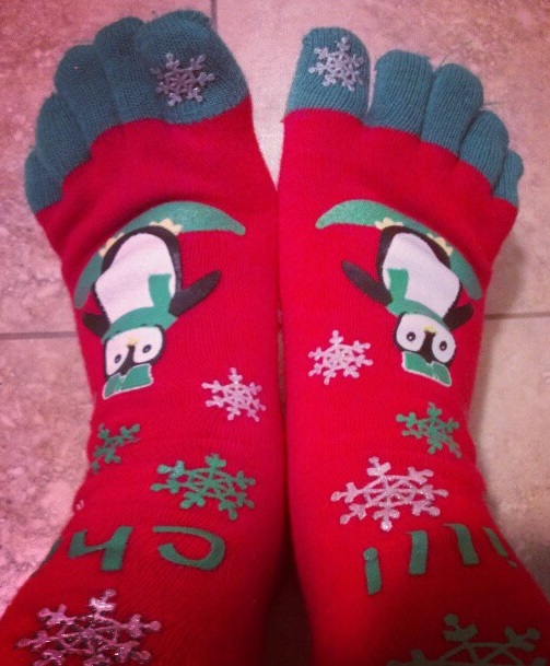 Adorable grey and red Christmas toesocks with snowflakes and penguin. Pic by chicagogal7