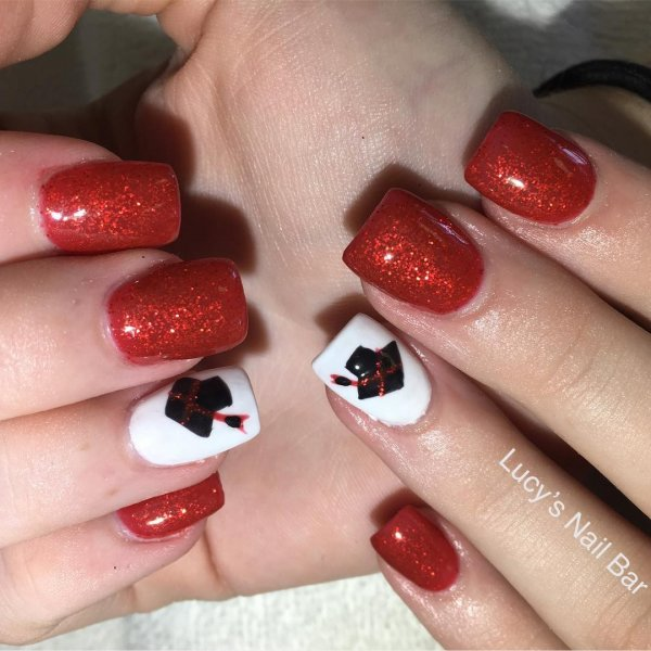 Beautiful red and white acrylic graduation nails. Pic by lucy_lashes_pmu via
