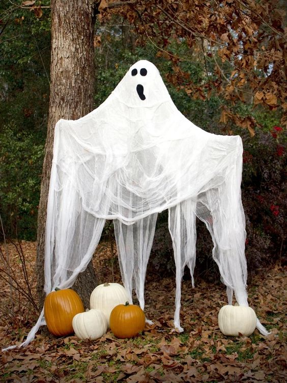 Best Halloween Decor With Pumpkins And Flying Ghost.