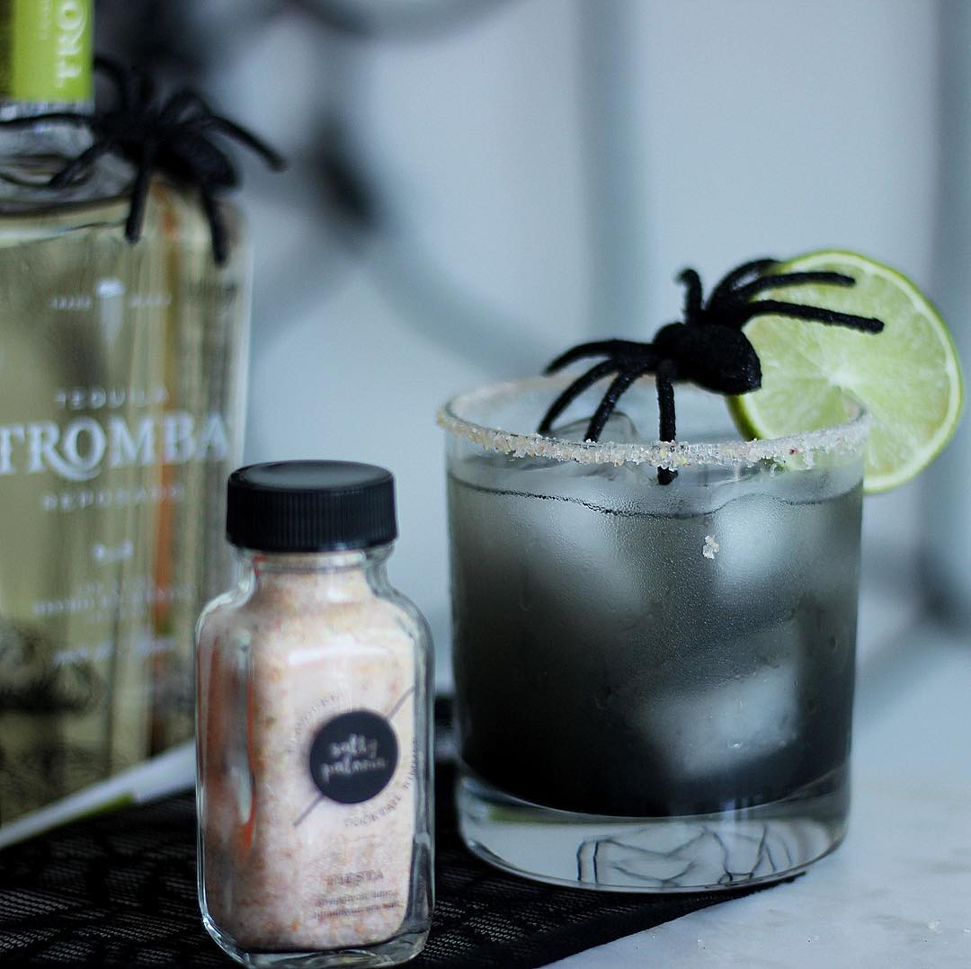 Black margarita cocktail decorated with spider. Pic by saltypaloma