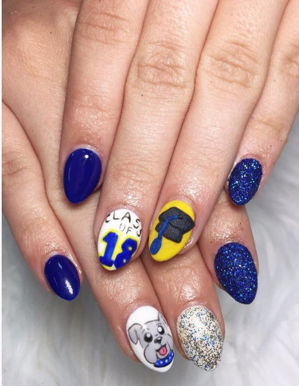 Blue and yellow graduation nails. Pic by nailsby_vy
