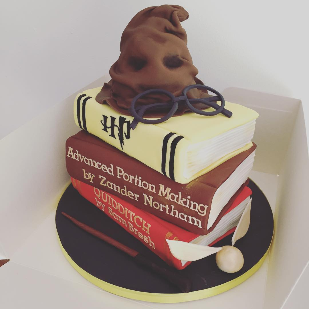 Book cake with sorting hat and golden snitch. Pick by cakes_by_nana