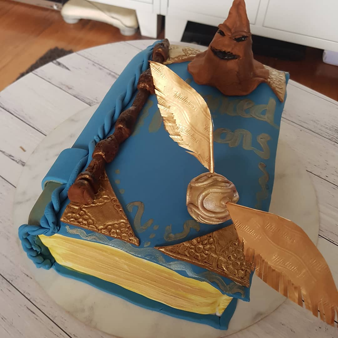 Chic harry potter book with golden snitch, sorting hat and wand. Pick by sunshinenrainbowsxx