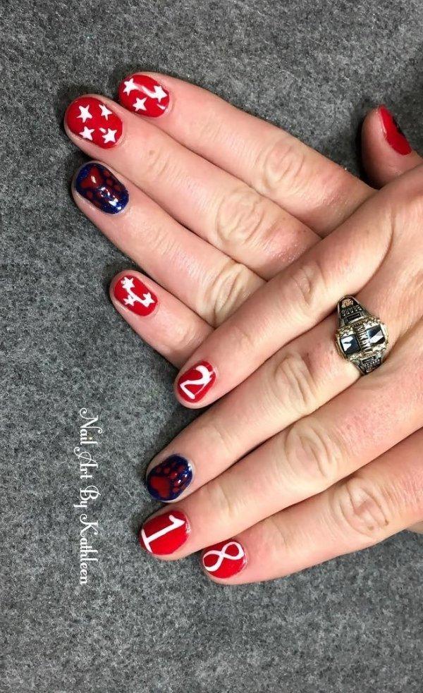Dashing red and black graduation nails. Pic by nailartbykathleen