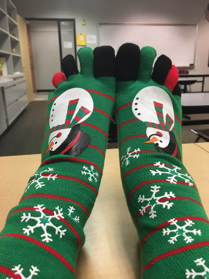 Exclusive green Christmas toesocks with snowflakes and snowman. Pic by Staci McDaniel Brown