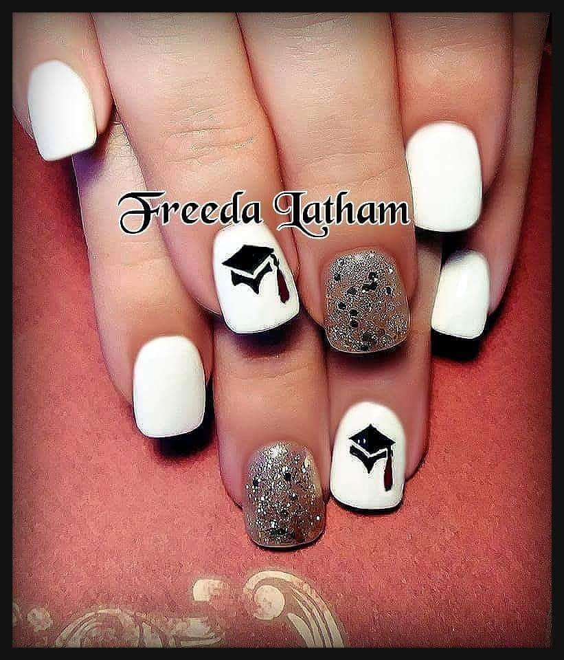 Impressive white short nails for graduation day. Pic by nailsbyjazandfreeda