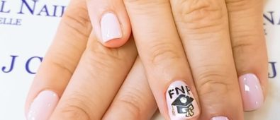 Pretty pink short nails with graduation cap. Pic by jcrystalplus