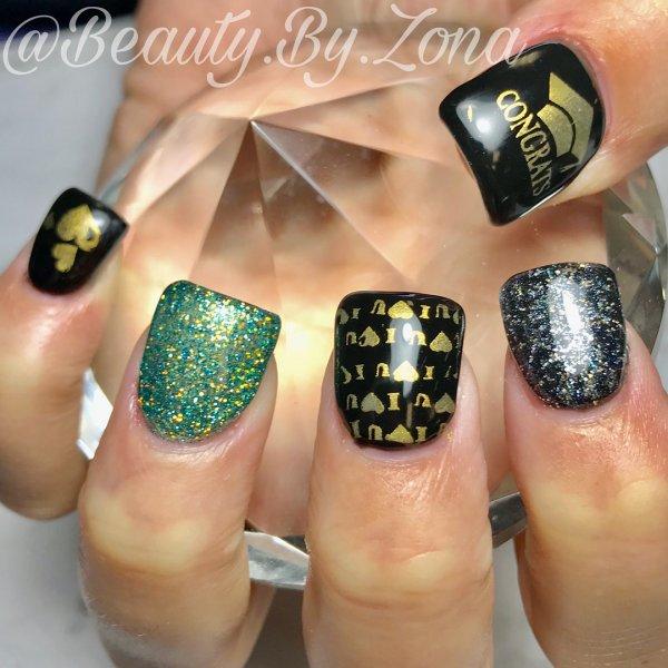 Ravishing black, green and golden graduation nails. Pic by arizonanorton
