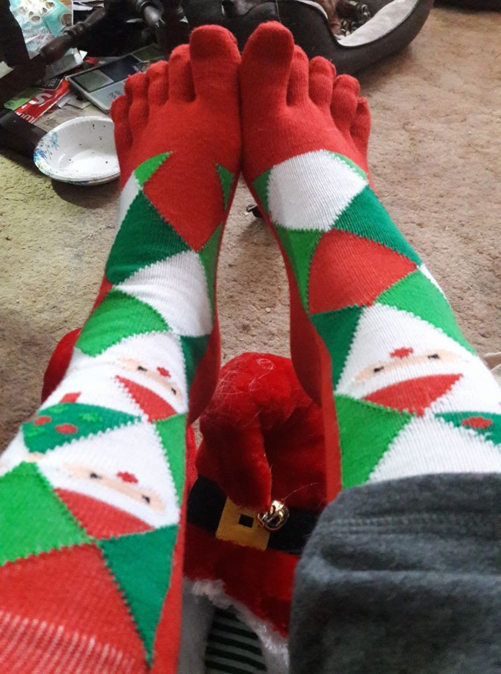 Red, green and white check Christmas toesocks. Pic by Jessica Chris Ojea