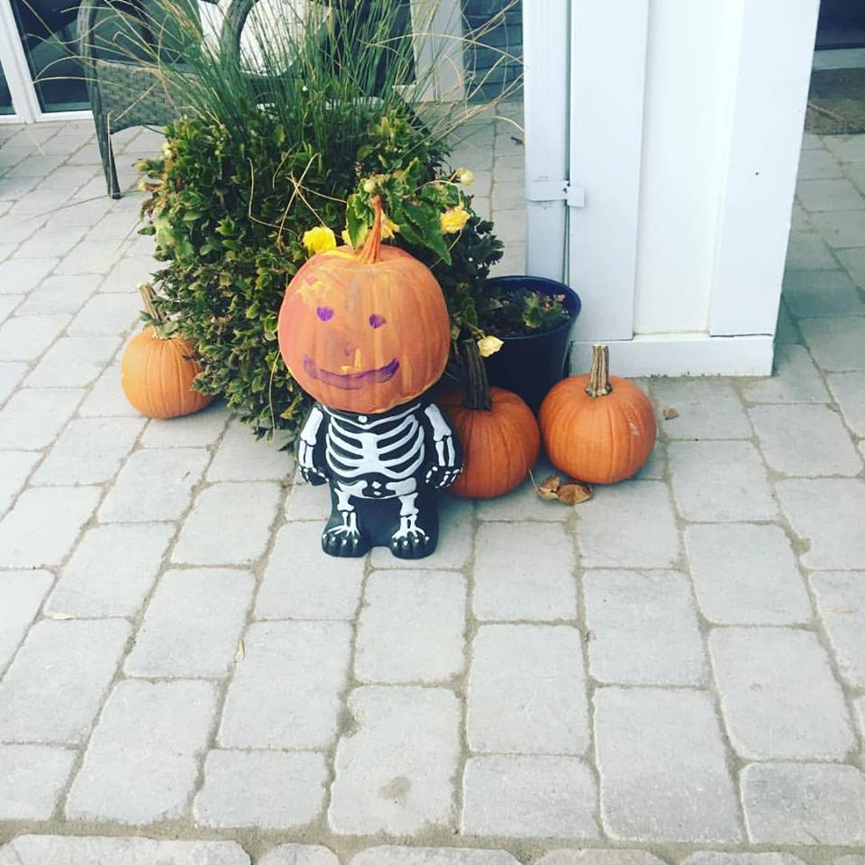 Rocking Little Pumpkin Headed Skeleton.