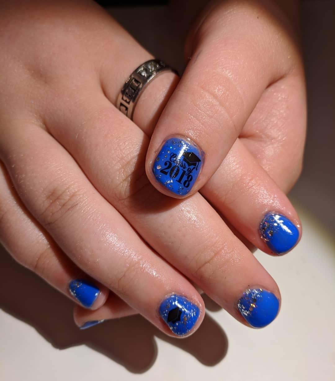 Rocking blue graduation nails. Pic by clarabellabeautybar
