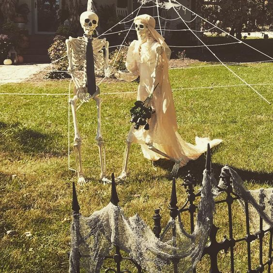 Skeleton Couple Used to Decorate Backyard for Halloween.