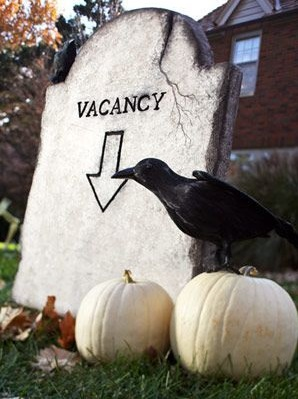 Spooky White Pumpkin and Crow Propped Cemetery Halloween Decor for Backyard.