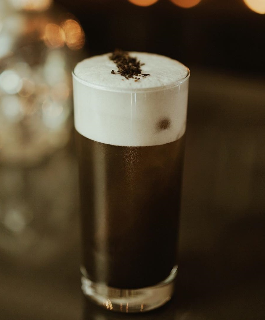 Tea infused bourbon, lemon, egg white, activated charcoal with orange soda. Pic by mixologyflaired