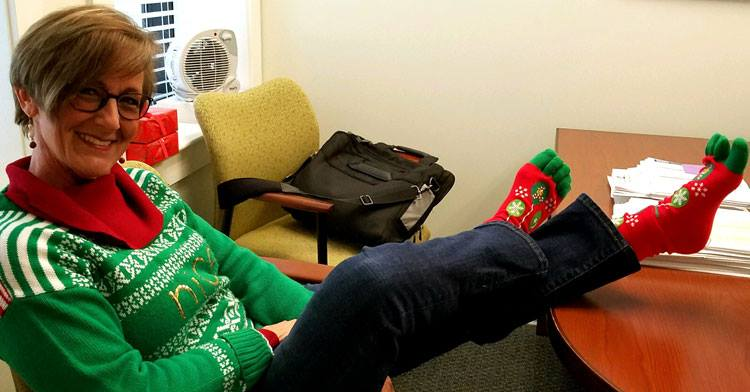 Ugly Christmas sweater with red and green socks. Pic by Five Star Credit Union