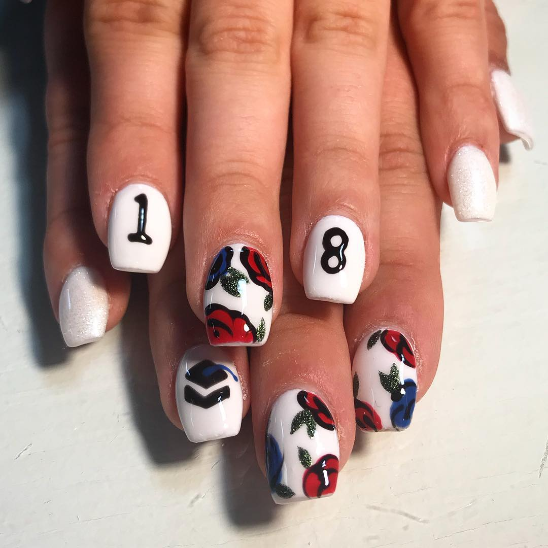 White gel nails with flower and graduation day cap. Pic by makenzie_brianne