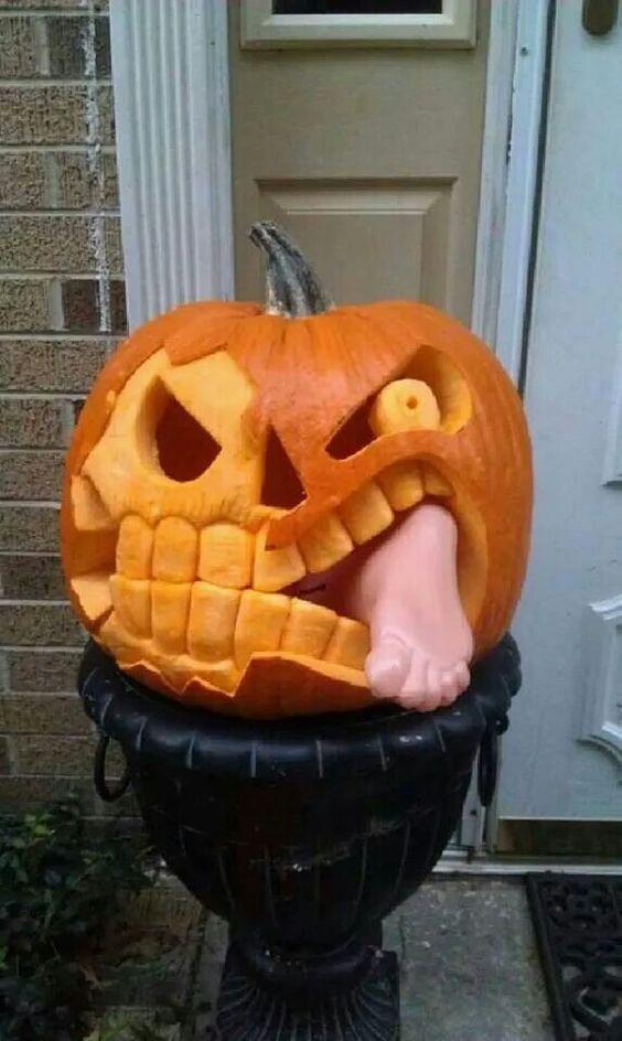 Adorable baby eating pumpkin carving idea.