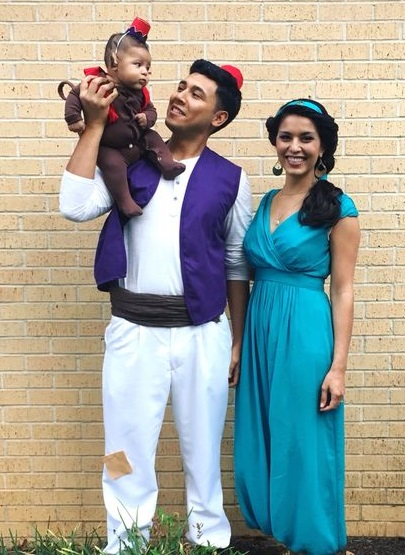 Aladdin, Princess Jasmine, and Abu the monkey family costumes for Halloween.