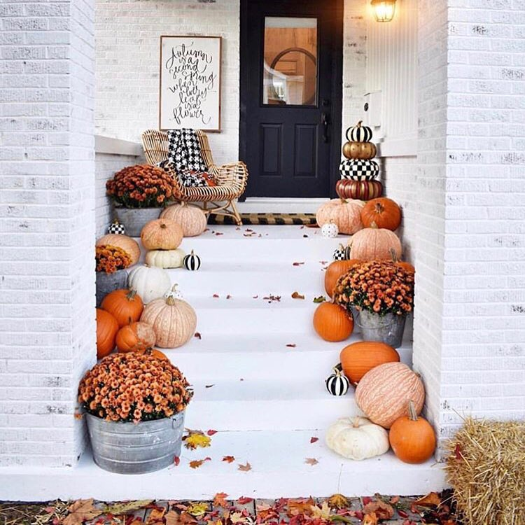 Artistic Halloween Front Porch Decoration with Pumpkin. Pic by home.with.lawrenceandgrace